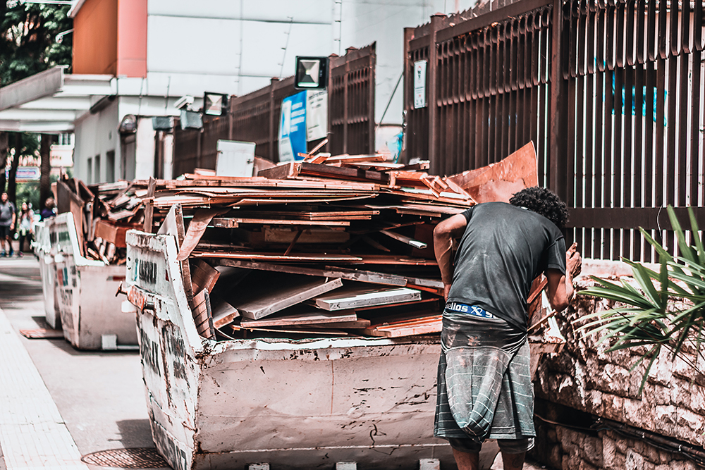 a man standing in front of Hong Kong waste