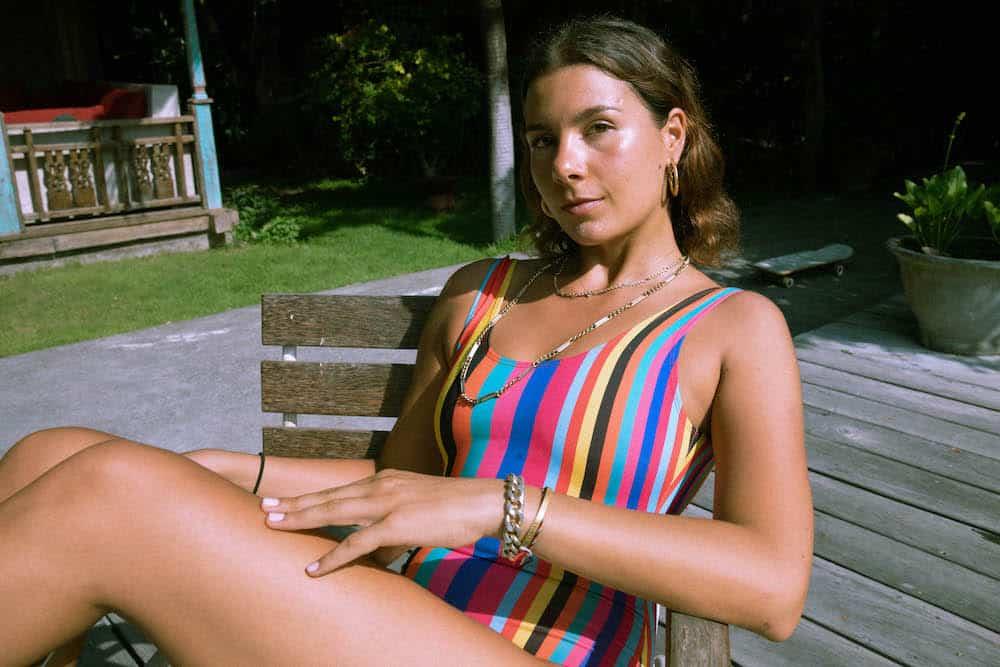 Girl wearing stripy swimsuit