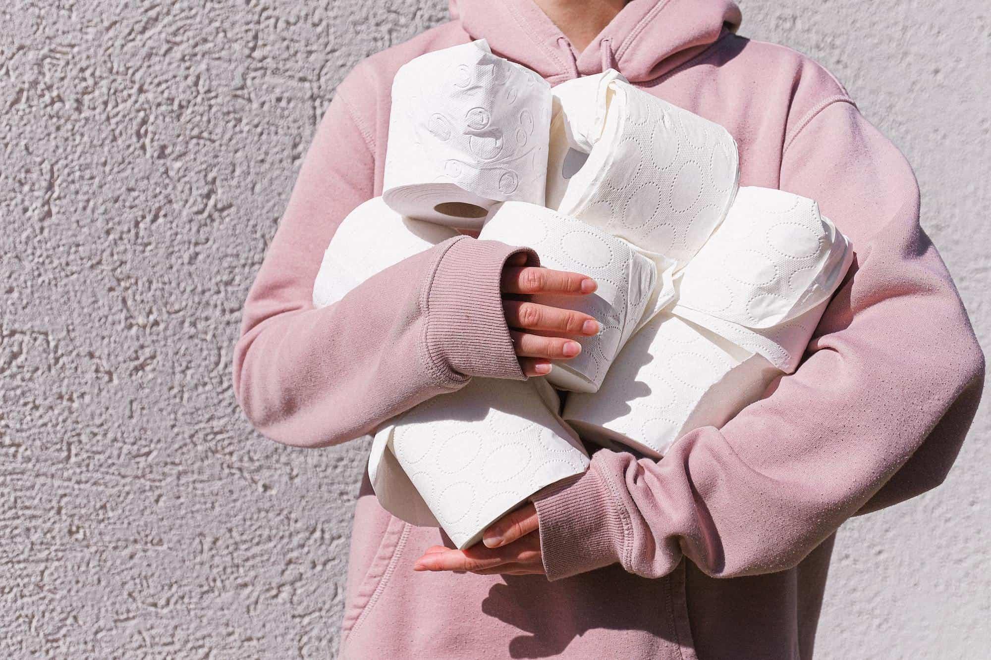 Girl holding toilet roll